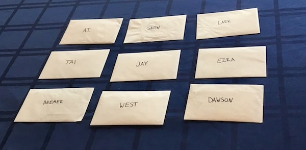 9 character envelopes, each with a different name on it.