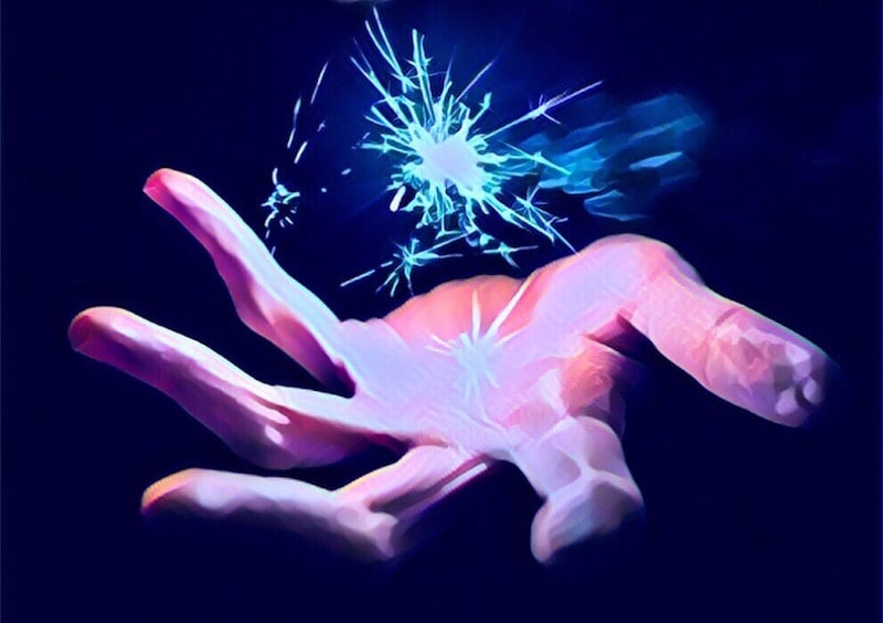 A hand with sparking magic