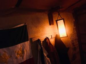 In-game: a Mexican flag, coats, and a lantern hanging on the wall of the Alamo.