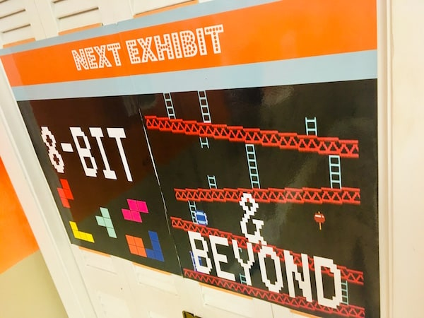 "In-game: A sign for the video game, ""8-bit & Beyond"" exhibit."