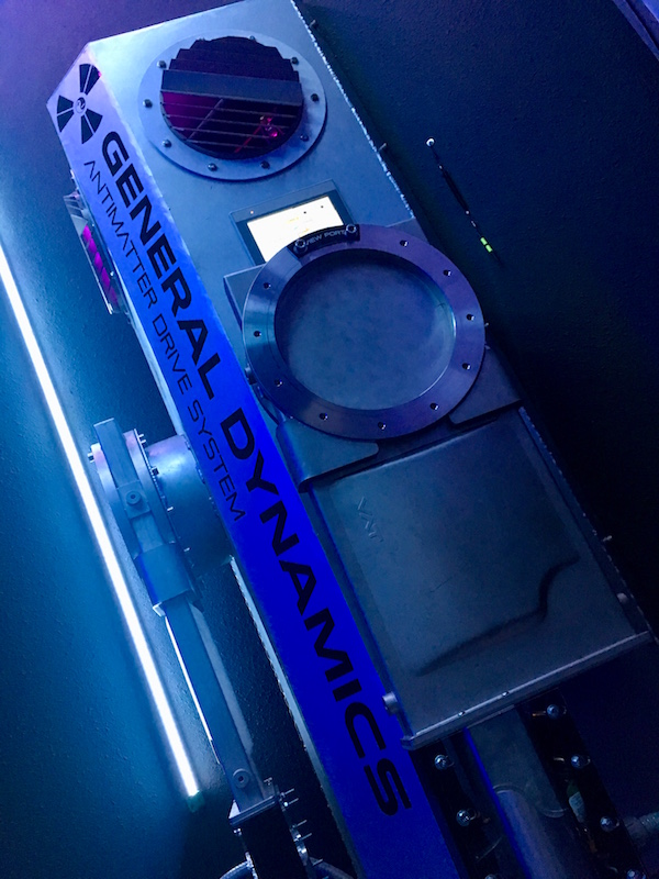 In-game: A tall metal Antimatter drive system. It's made entirely of metal and looks imposing.