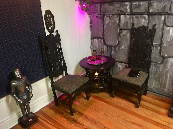 In-game: A small round table with two chairs beside it.