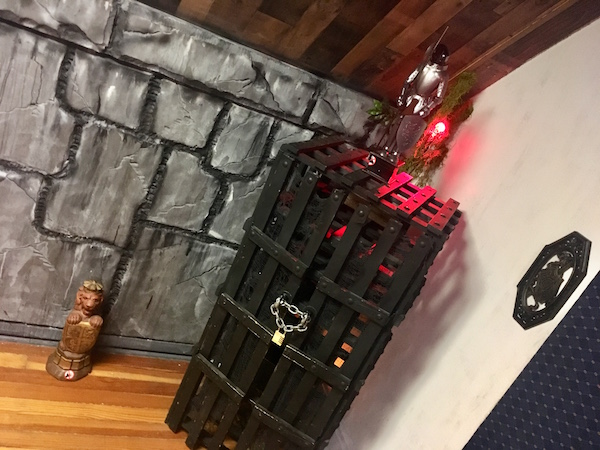 In-game: A tall locked chest with a knight statue atop it.