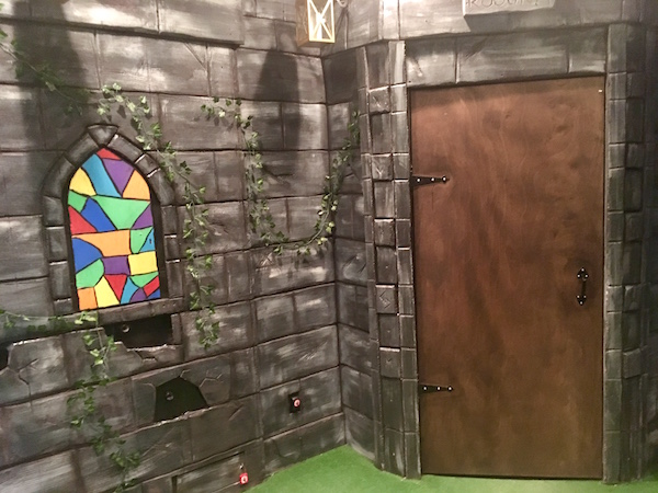 In-game: A castle wall with faux stain glass.