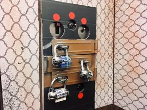 In-game: an elevator control panel covered in hasps and locked up.