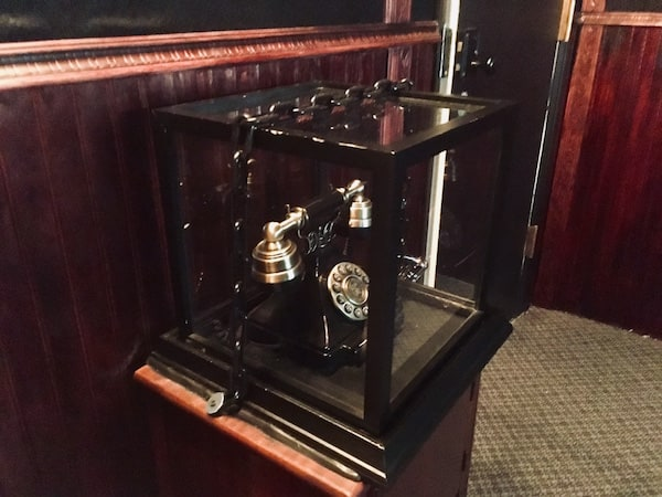 In-game: A faux rotary phone encased in glass and chained shut.