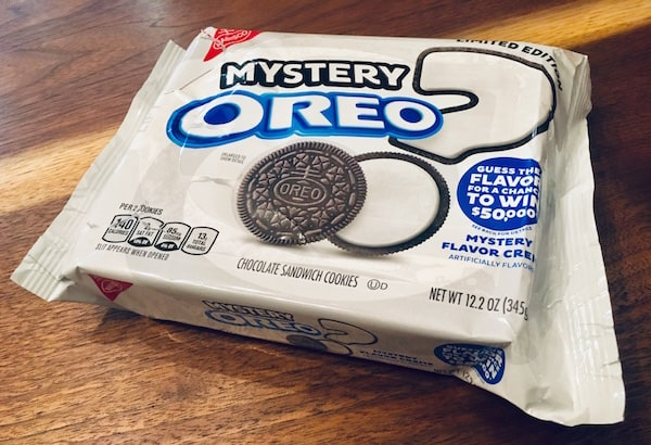 The bright white Mystery Oreo packaging with a question mark dotted with an oreo.