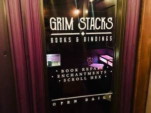 In-game: The doorway to the Grim Stacks Books & Bindings store.
