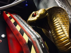 In-game: Closeup of a king cobra statue surrounded by technology.