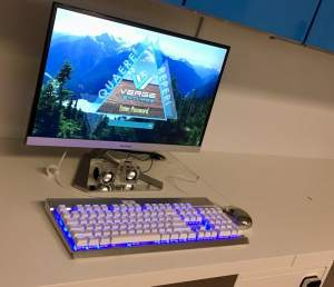 In-game: a computer on a desk with a Verge Ventures login screen.