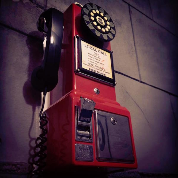 In-game: a red faux rotary pay phone.
