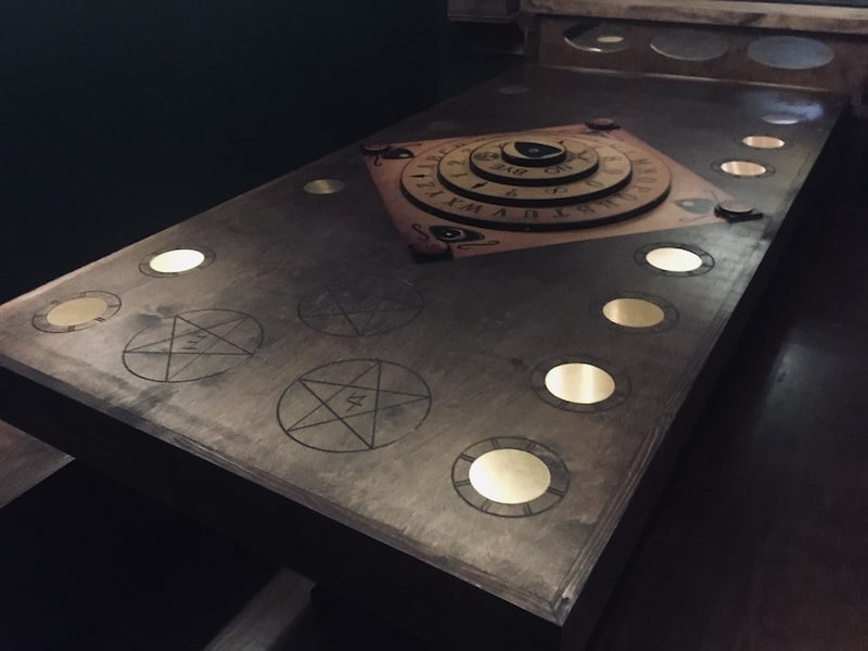 In-game: A Ouiji board-like device on a seance table.