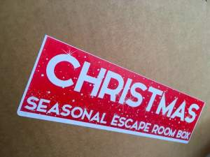 "The game's shipping box labeled, ""Christmas Seasonal Escape Room Box"""