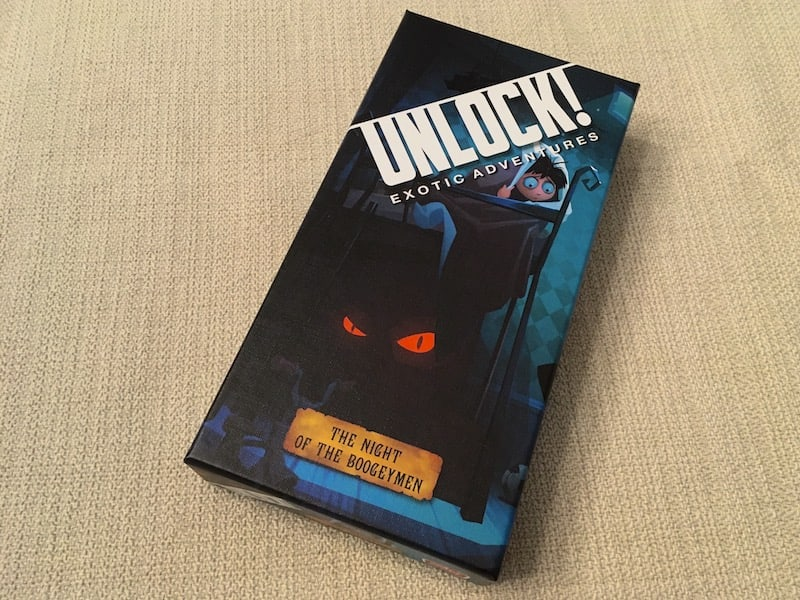 Unlock's The Night of the Bogeymen box art depicts a cartoonish child hiding under the covers from a monster with red glowing eyes under the bed.