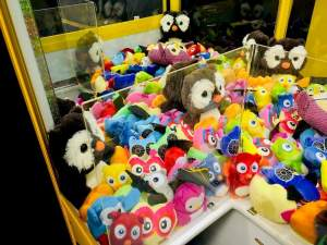 In-game: the inside of a claw machine, filled with stuffed animals.