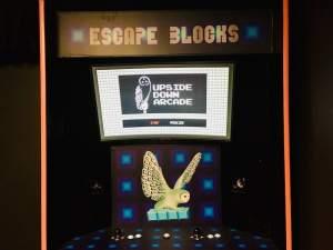 In-game: The Escape Block arcade cabinet.