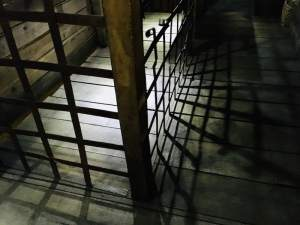 In-game: A caged area inside of an old ship.