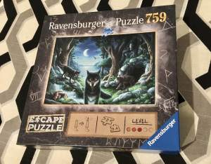 Ravensburger's The Curse of the Wolves Escape Puzzle box art depicting a pack of wolves in the moonlight.