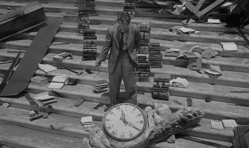 "The iconic scene from The Twilight Zone's ""Time Enough at Last."" The man on Earth surrounded by his books just before he breaks his glasses."