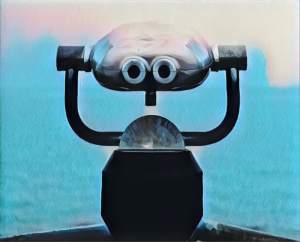 Mounted binoculars overlooking water.