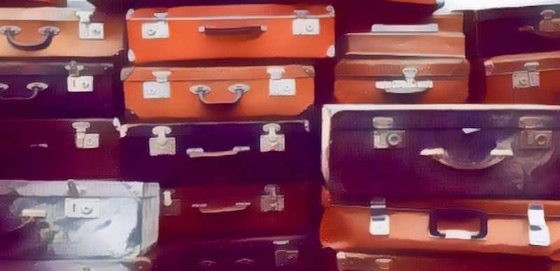 Stylized image of a large stack of assorted luggage.