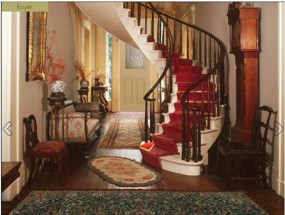 A spiral staircase in a stately manor.