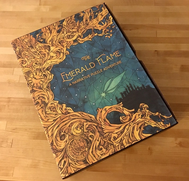 The gorgeous gold and green stained glass box art of The Emerald Flame.