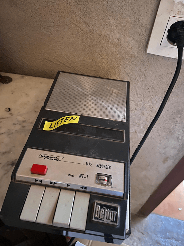 "An old tape recorder with a sticker on it that reads, ""Listen"""