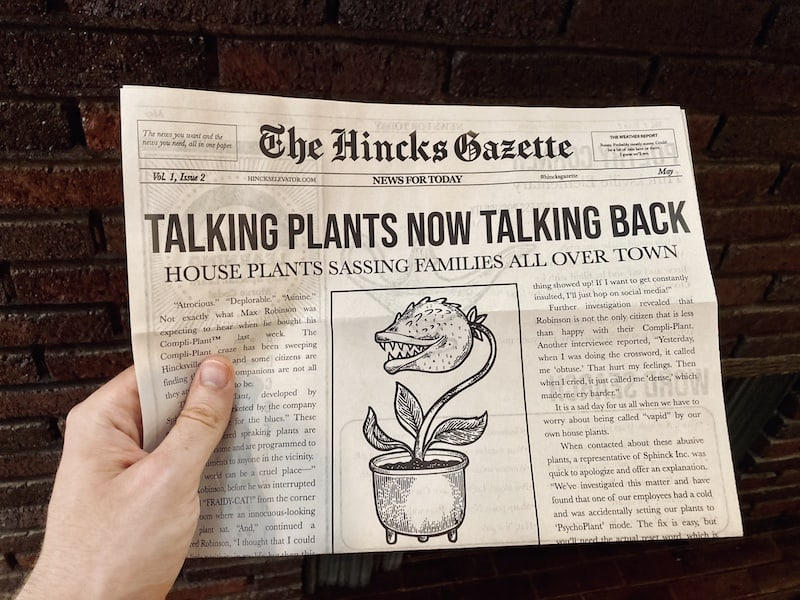 "A copy of the Hincks Gazette being held up in front of a fireplace. The frontpage headline reads, ""Talking plants now talking back. House plants sassing families all over town."""