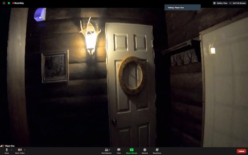 An interior door in a log cabin.