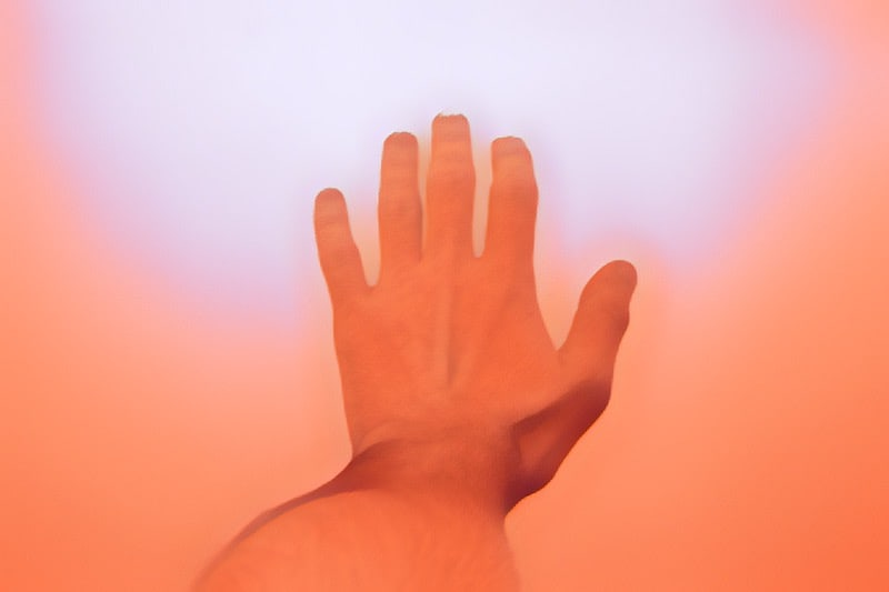 First-person view of a hand reaching out.