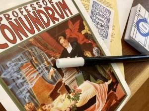 Closeup ov Professor Conundrum's poster and wand.