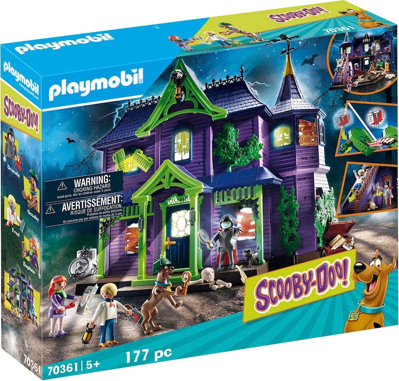 A purple and green haunted house playset with Scooby-Doo Playmobile characters.