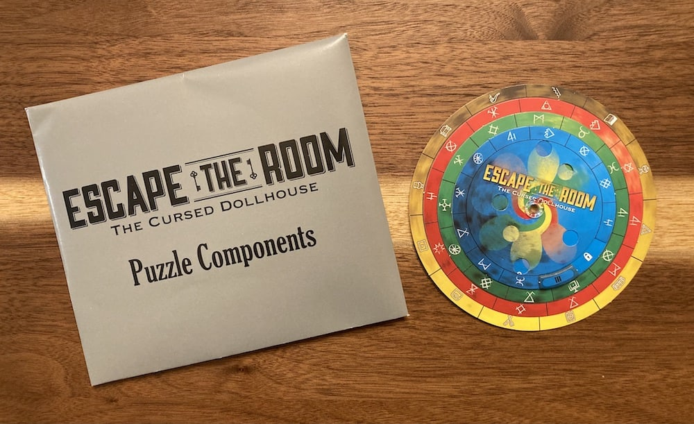 A sealed puzzle component envelope and an a solution disk.