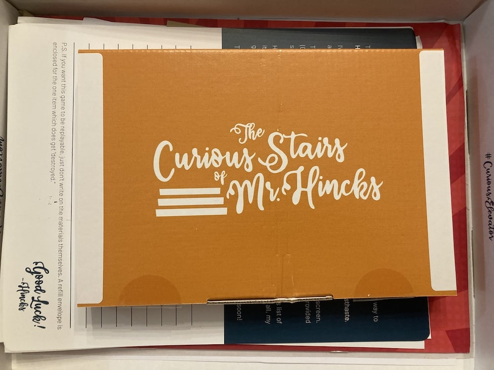 """Yellow """"Curious Stairs of Mr Hinks"""" box sitting inside the """"Curious Elevator's"""" box/"""