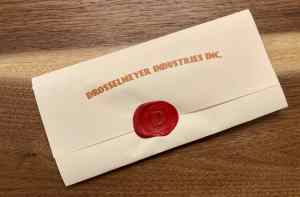 A wax sealed envelope from Drosselmeyer Industries Inc.