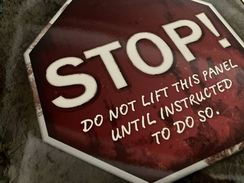 """A warning, """"Stop! Do not lift this panel until instructed to do so."""""""