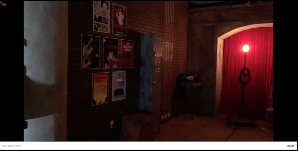 Backstage at the Haunted Theatre has posters and an illuminated ghost light.