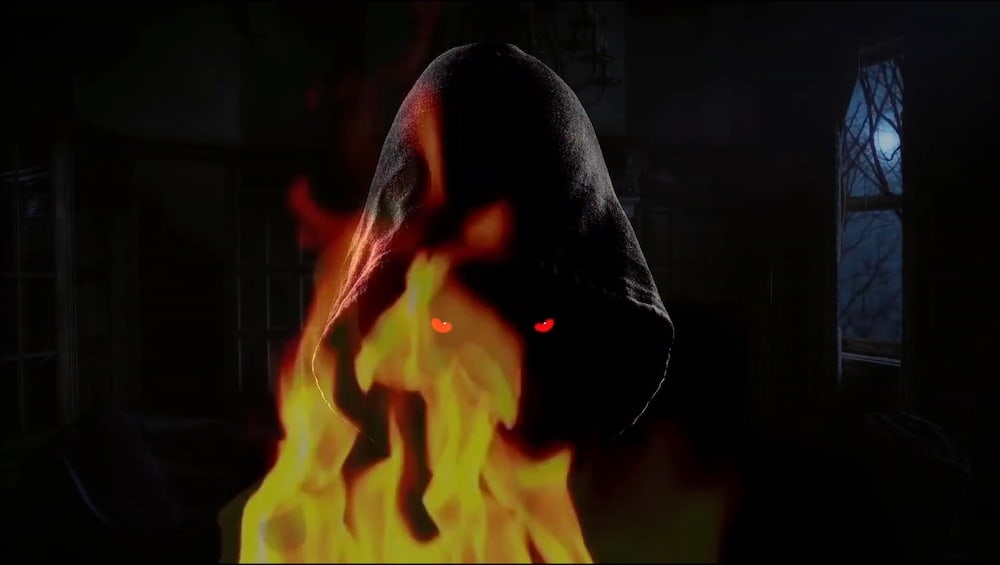 A cloaked individual with glowing red yes surrounded by fire.