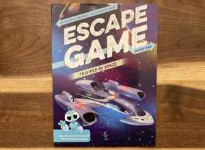 Cover art for Escape Game Adventure Trapped in Space shows a damaged spaceship.