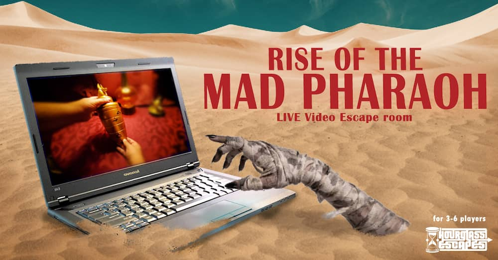 Promo art for Rise of the Mad Pharaoh shows a mummy hand reaching out of the sand towards a laptop.
