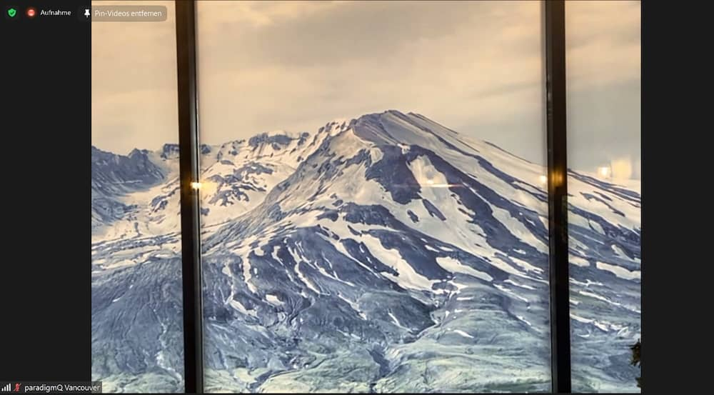View of a snow-covered mountain through a window.