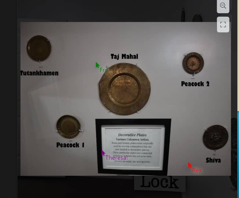 5 labeled plates on a wall in a museum.
