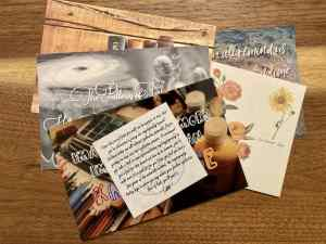 Puzzle post cards fanned out.