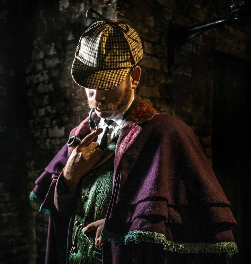 Sherlock Holmes smoking his pipe.