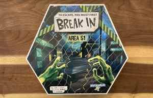 Break In Area 51 box art shows alien hands opening a chainlink fence.