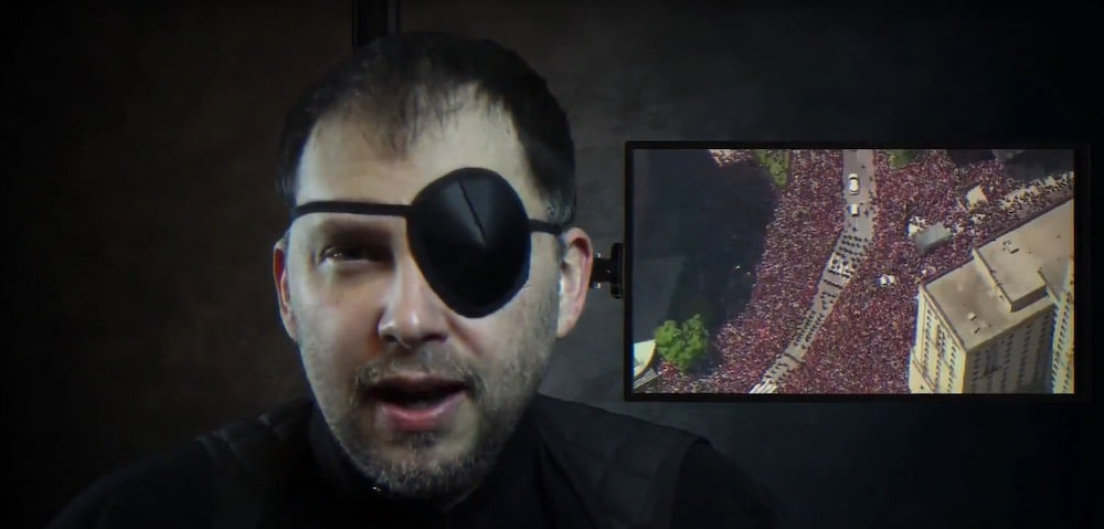 In-game spy character with an eye patch.