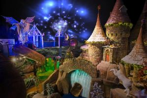 Indoor playground with fantasy themes including a castle, unicorn and slides.