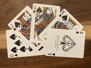 A royal flush of spades from David Kwong's Enigmas deck.