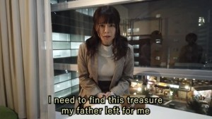"""The main character in her apartment pleading, """"I need to find this treasure my father left for me."""""""